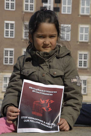 kidnapping: .Copenhagen.Denamrk _11 April 2015_ Hazara community living in Copenhagen shiite by faith protesting infront the danish aprliament aginst kidnapping 31 hazaras in Afganistan, Mr.president break your strategic silence and brik back hostages from there were