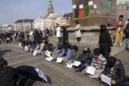 hostages: .Copenhagen.Denamrk _11 April 2015_ Hazara community living in Copenhagen shiite by faith protesting infront the danish aprliament aginst kidnapping 31 hazaras in Afganistan, Mr.president break your strategic silence and brik back hostages from there were