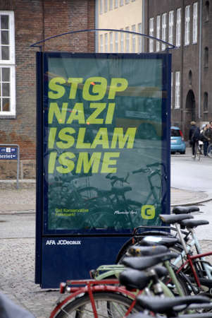 pubic: .Copenhagen.Denamrk _15 April 2015_  _Public photographing and stand and look at Conservative political party elections billboard  Stop Nazi islam isme which taking ciritcism heat in denmark