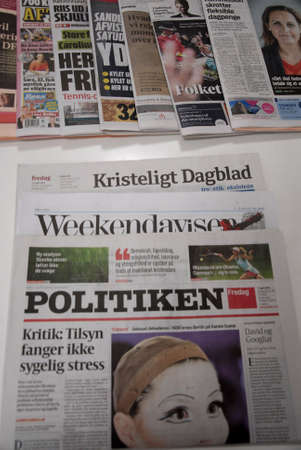 francis dean: .Copenhagen.Denamrk _17 April 2015_Various danish largest dailies lying on table Editorial