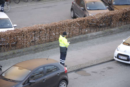 parking ticket: .Copenhagen.Denamrk _17 April 2015_ Inpector gives parking ticket and getting agrument with female on kastruplundgade in kastrup early morning on f riday