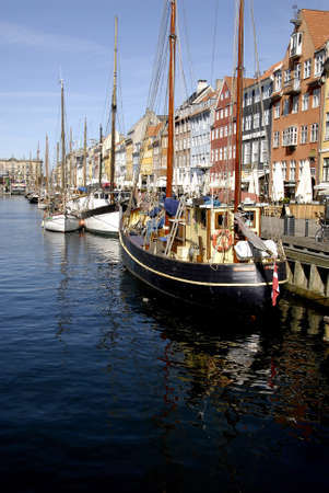francis joseph dean: Copenhagen, Denamrk _20 April 2015_Life restauant and tourists boats at Nyhavn channelor canal today on monday