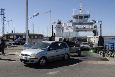 autos: HUNDESTEDDENMARK. 21April 2015    _Danish small  fairy   Isefjord hundested sail between  hundested and Roervig carry autos and people