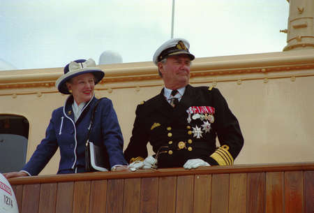 city people: H.M.the Queen Margrethe II & prince Henrik  of Deanmark  on royal ship Danneborg sailed  to danish 2.nd city Aarhus and greet local  city people of  Aarhus Denmark on July 2,1999