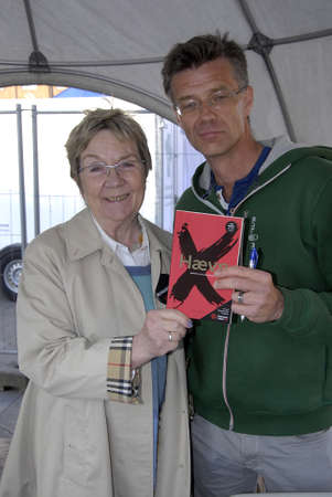marianne: COPENHAGENDENMARK. 23 April 2015   _Ms.Marianne jelved danish minister for culture and sports with author Robter Zola Christen with his book Revange  danish minister for culture Ms.marianne Jelved gives away free books to dane to read on Denmarks readin