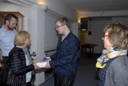 francis dean: Helerve-.Copenhagen.Denamrk _27 April 2015_  Ms.Pia Kjaersgaard  former leader of danish people party and politicians and for danish people party visist  Center for Autisme in Herlev  and 21 years Oliver Wittzner gives Danish sousages present to Ms.Pia Kj