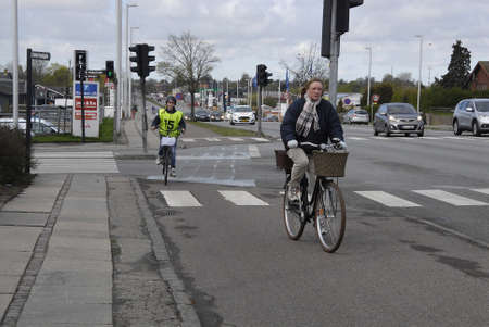 youngs: .Copenhagen.Denamrk _27 April 2015_ Gladsaxe police (Gladsaxe polii) joint venture with teeageagers and children for bycycle or bike testing and educating youngs how to ride biycycle in traffif Editorial