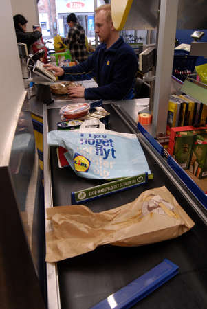 german food: Copenhagen Denamrk _11 May 2015_ Consumeer shopping in German food chain store Lidl in Copenhagen