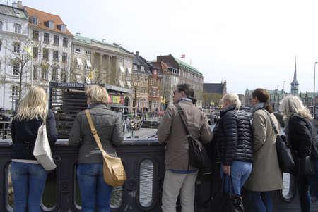 francis dean: Copenhagen Denamrk _11 May 2015_ Foreign holiday makers standing on bridge