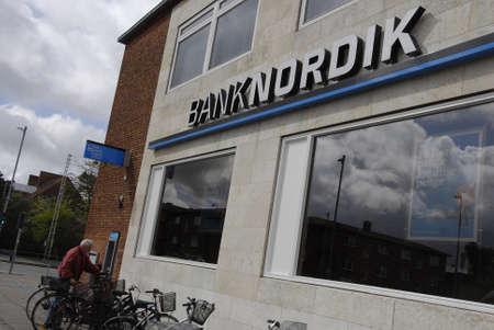automat: Kastrup.Copenhagen.Denamrk    13 May  2015     Elderly an cahsing money at Banknordik atm at amagerlandvej Editorial