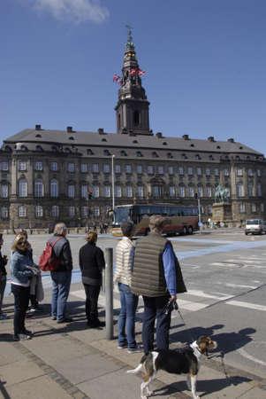 may fly: Copenhagen Denamrk _14 May 2015_ Foreign visitor on religios holyday danish flag fly over danish aprliament folketinget