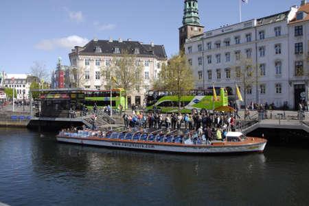 francis dean: Copenhagen Denamrk _14 May 2015_ Foreign visitor on religios holyday danish flag fly over danish aprliament folketinget