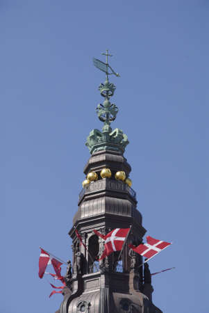 holyday: Copenhagen Denamrk _14 May 2015_ Foreign visitor on religios holyday danish flag fly over danish aprliament folketinget