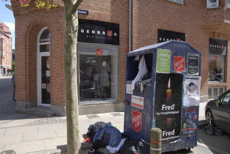 francis joseph dean: Copenhagen Denamrk _14 May 2015_  Peopple leave old cloths at salvation army chairty container infron 2nd hands sale store on amager