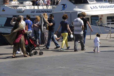 immigrants: BARCELONA SPAIN _28 May 2015_  Muslim women with head srafs travelers and demostic living immigrants in Barecelona Catalonia,Spain Editorial