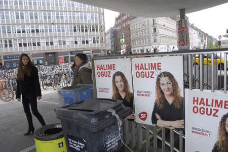 scum: COPENAHGEN DENAMRK 02 jUNE  2015_Unknow nperson vandelized danish elections  posters and wrote  nazi scum on one of danish poeples party candiate poster
