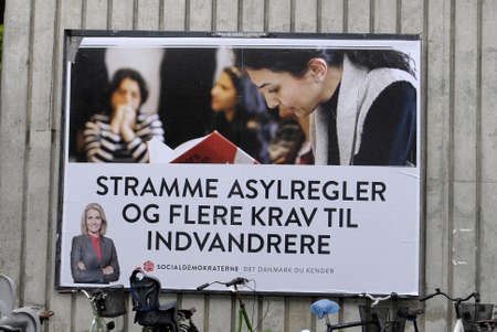 democrat party: COPENAHGEN DENAMRK 03June  2015_  Prime minister Helle Thorning-Schmidt approvided message on elections  her re-elections poster and sociasl democrat party line  Tightening the asylum rules and putting  accpectating  on immigrats to contribute to danish