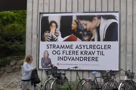 helle thorning schmidt: COPENAHGEN DENAMRK 03June  2015_  Prime minister Helle Thorning-Schmidt approvided message on elections  her re-elections poster and sociasl democrat party line  Tightening the asylum rules and putting  accpectating  on immigrats to contribute to danish