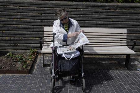 news paper: Kastrup.Copenhagen.Denamrk    14 June  2015  Elderly women taking rest and read free news paper
