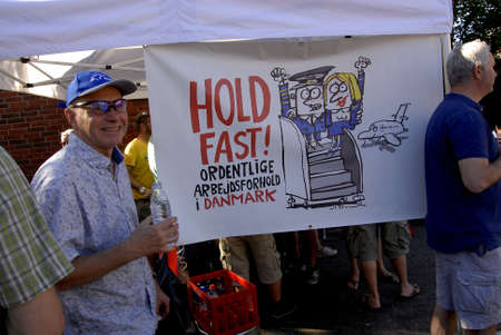 obey: COPENAHGEN DENMARK 01 July  2015_  3ftrade union member celebrate and holding party  with beer sausage and dance danish labour court rulling in favour of danish trade union and agianst Ireish Ryanair compnay ,ryainair must obey danish workin and wages ru