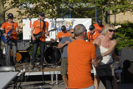 COPENAHGEN DENMARK 01 July  2015_  3ftrade union member celebrate and holding party  with beer sausage and dance danish labour court rulling in favour of danish trade union and agianst Ireish Ryanair compnay ,ryainair must obey danish workin and wages ru