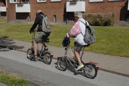 Kastrup.Copenhagen.Denmark  08 July  2015    Senior couple bicycling in Kastrup