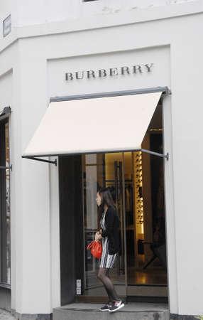 shopper: CopenhagenDenmark 13 July 2015_Asian shopper entering in Burberry store in Copenhagen