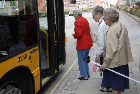 Kastrup.Copenhagen.Denmark  15 July  2015     _Eldlerly female waiting for bus nr.36 at Kastruplundgade bust stop