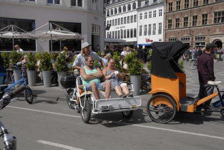 CopenhagenDenmark 17 July 2015_Tourists discover Copenhagen by rickshaw transportaion Editorial