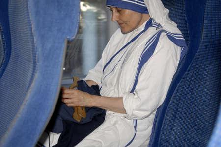 CopenhagenDenmark 17 July 2015_ Nun from mother teresa mission saying her prayer  during  journey by danish public transportation  system