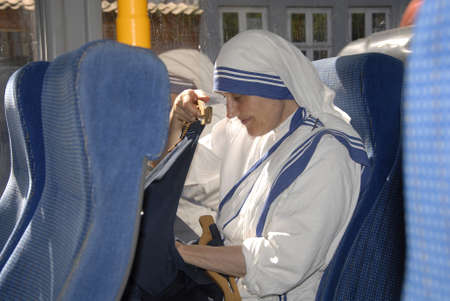 Mother Teresa: CopenhagenDenmark 17 July 2015_ Nun from mother teresa mission saying her prayer  during  journey by danish public transportation  system