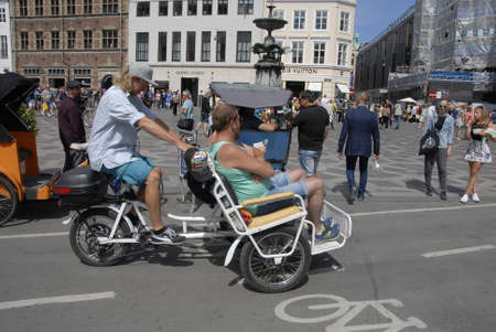 transportaion: CopenhagenDenmark 17 July 2015_Tourists discover Copenhagen by rickshaw transportaion Editorial