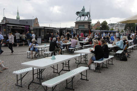 CopenhagenDenmark 18 July 2015_ Pubic enjoying food at Copenhagen Food festival infront danish parliament building Christiansborg Palace