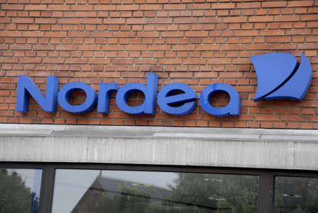 bank branch: CopenhagenDenmark 21 July 2015_ People cash money at ftm at Nordea bank branch