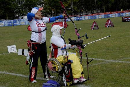 wheel chair: CopenhagenDenmark 29 July 2015_Russian team female  Ksenia Perova and Irian team female Zahra Nemati on wheel chair during shotting season side by side  at World Archery Championshiips 26 july - 2 august 2015 in Copenhagen, Denmark