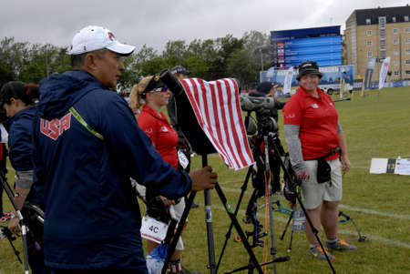 delegates: CopenhagenDenmark 28 July 2015_sports life at World Archery Championshiips 26 july - 2 august 2015 in Copenhagen, Denmark ,usa women  delegates Mss.Jimmie Van Vatt ,Crystal Gauvin and Lexi Kelleer on ground at World Archery Championships.