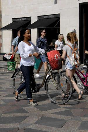 vacationers: CopenhagenDenmark 05 August  2015_ Shoppers walk  on stroeget during Copenhagen Fashion Week for next 5 days