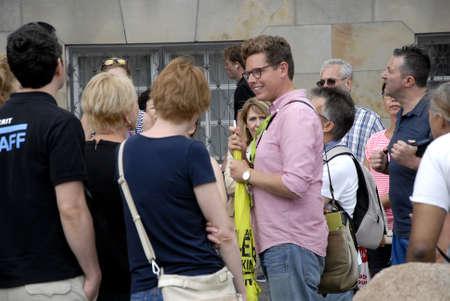 tourist guide: CopenhagenDenmark 07 August  2015_  Holiday makers in Copenhagen with tourist guide Editorial