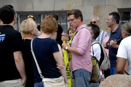 vacationers: CopenhagenDenmark 07 August  2015_  Holiday makers in Copenhagen with tourist guide Editorial