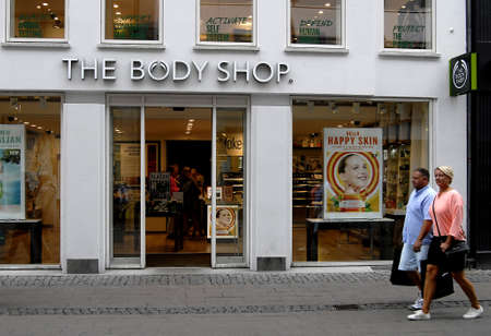 body shop: CopenhagenDenmark 12 August  2015_Shoppers pass by The body shop on stroeget