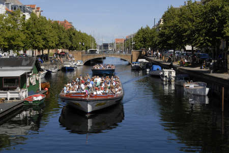vacationers: CopenhagenDenmark 13 August  2015 -Life by Visitors and local  at Christianshavn  canal most famous and visting canal in Amager island in heart of Copenhagen Editorial