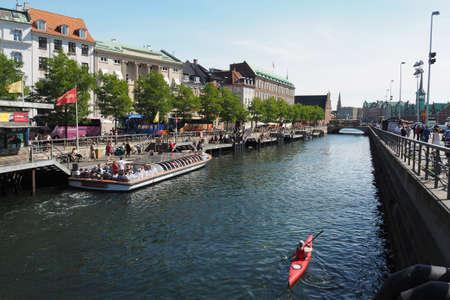 vacationers: CopenhagenDenmark 22 August  2015_Travelers copenahgen site from hojbro bridge christiansborg plads Editorial