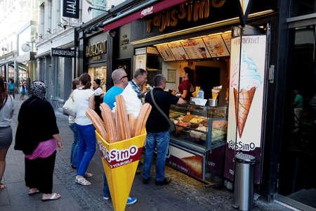 visitors: CopenhagenDenmark 22 August  2015_ Visitors waiting at ice cream shop on strogoet Editorial