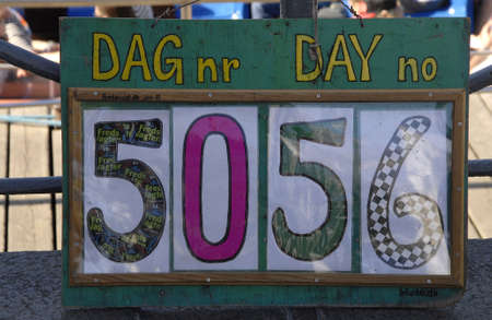 anti war: CopenhagenDenmark 23 August  2015_ Eldler woman from peace wtach group stands infron of danish ministry of defence and  denmark today marks 5056 day today  peace today been removed from danish parliament site to defence ministry due to sports event in C