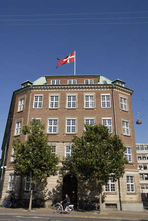 CopenhagenDenmark 23 August  2015_ Eldler woman from peace wtach group stands infron of danish ministry of defence and  denmark today marks 5056 day today  peace today been removed from danish parliament site to defence ministry due to sports event in C