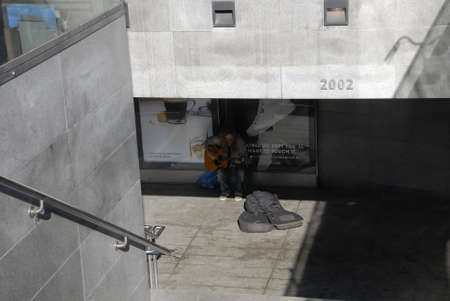 entertainer: CopenhagenDenmark 23 August  2015_   Street entertainer singer singing for cash at christianshavn metro train station