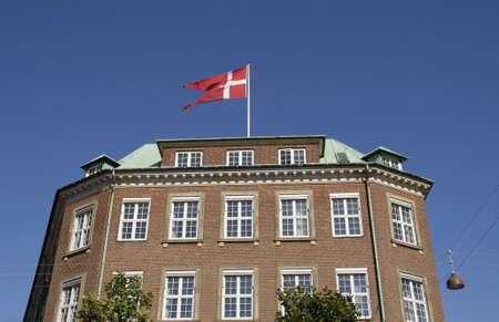ministry: CopenhagenDenmark 23 August  2015_Danish flag flys over danish ministry of defence Editorial