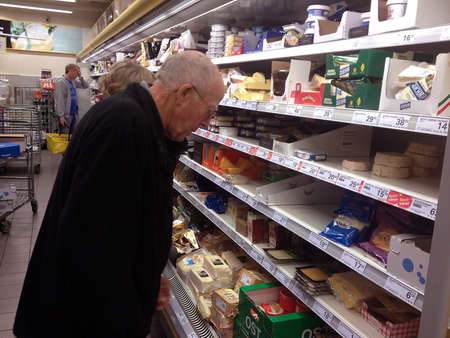 milk products: CopenhagenDenmark 26 August  2015_    Milk products milk and cheeses at grocery store Editorial
