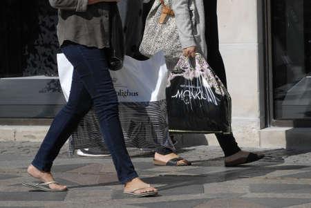 plastic bags: CopenhagenDenmark 02 September   2015_ Shoppers with shopping plastic  bags on stroeget Editorial