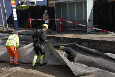 kastrup: Kastrup.Copenhagen.Denmark  07 September  2015 _Asphalt workers  are working on Amagerlandvej in Kastrup